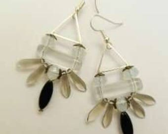 Earrings with their daggers and pearls