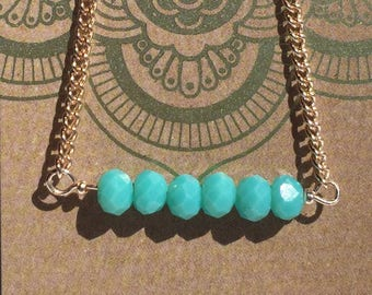 "7"" aqua bead and rose gold bracelet"