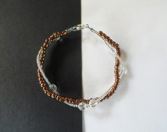 Two strand twisted bracelet silver and bronze coloured