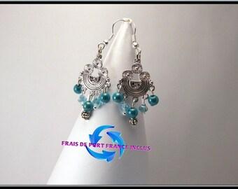 Boucles d'oreille perle cristal de swarovski et perle magique.