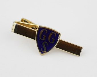 Shield Shaped Gold Plated Simple Monogram GGS Pinch Grip on Tie Clip has BlueEnamel Front