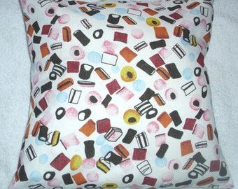 Liquorice Allsorts  on white cushion