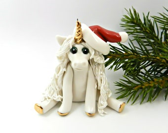 Unicorn Christmas Ornament Figurine wearing Santa Hat