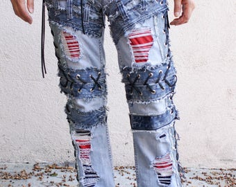 Vintage Blue jeans chopper style side lace ups with damage holes of red, blue, and white