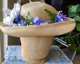 straw hat with lilac & blue flowers