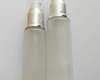 30ml or 50ml Frosted glass Bottles with white lotion pump, silver collar, and clear overcap
