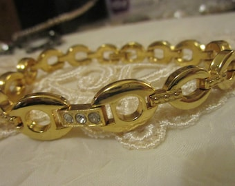 """vintage goldtone link bracelet with three diamante 7.5""""across in great condition 1/2""""wide"""