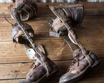 Antique old pair of children prosthetic leg with shoes leather metal wood