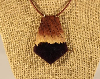 Red mallee burl with purple acrylic pendant