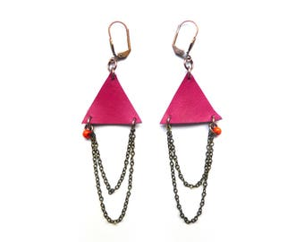 Earrings are made of pink leather and chains