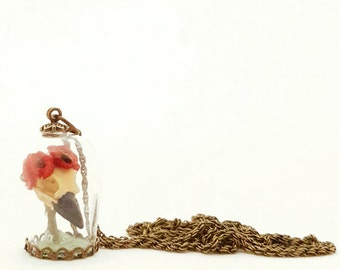 Miniature Replica Magpie/Crow Skull with Red Flower Crown in Glass dome Necklace