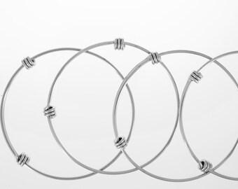 Bangle bracelets in stainless steel.  Expandable bracelets. Bangles.  Bangle bracelets.