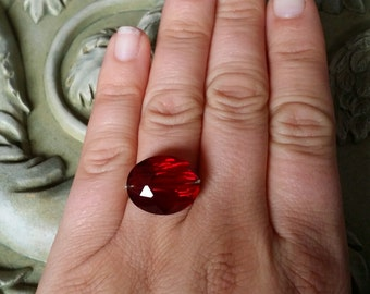 Sterling silver wire wrapped ring with red crystal