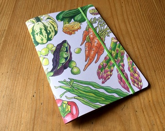 Garden vegetables notebook, pocket sized, ruled with an original illustrated cover and recycled paper.