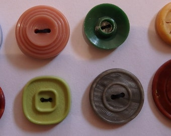 8 assorted plastic and celluloid buttons