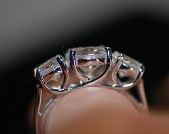 Three stone journey ring; sterling silver; cubic zirconia; round cut; famous maker; size 7-1/4 US; Free shipping USA