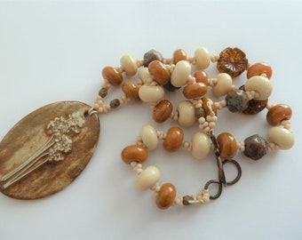brown and cream lampwork and ceramic copper necklace, uk artisan jewellery