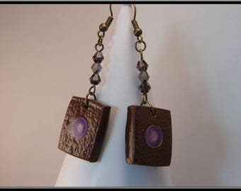 Polymer clay earrings with inlay paint and resin.