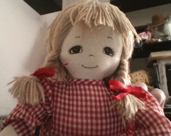 Rag doll with red dress