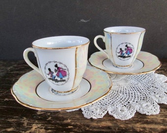 Set of two Colonial Couple Designed Teacups and Saucers