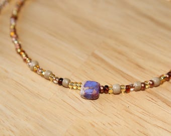 Brown seedbead necklace with purple stone