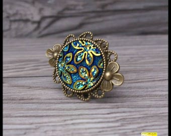 iridescent turquoise, blue flower cabochon ring on adjustable bronze ring
