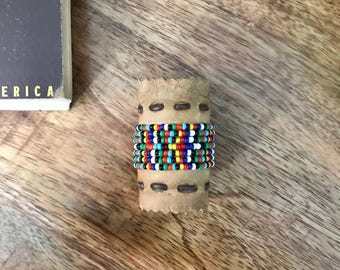 Vintage Boy Scout Neckerchief slide.  Detailed hand beading on this handmade slide.  from early 1960's.  Nice Condition