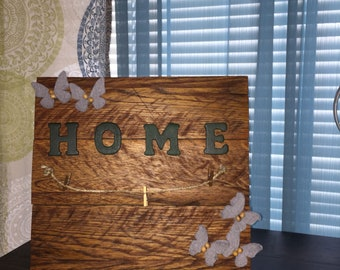 Beautiful home sign with places to hang up pictures