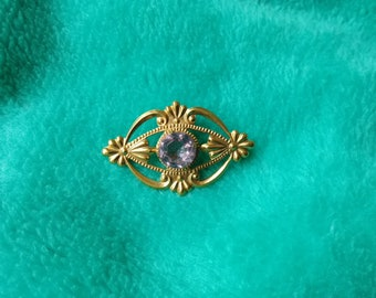 vintage brooch with pink gemstone