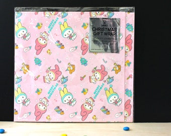 Sanrio pink vintage 1980s Christmas gift wrap paper.