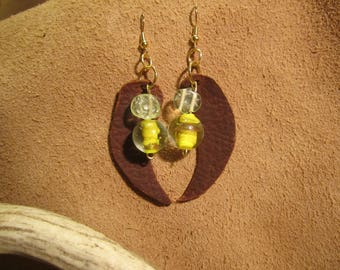 Brown leather and yellow beaded earrings