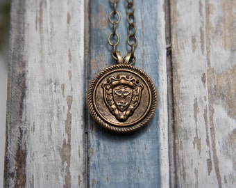 SALE ITEM Coat of arms/Family Crest Pendant Necklace with a brass colored chain.