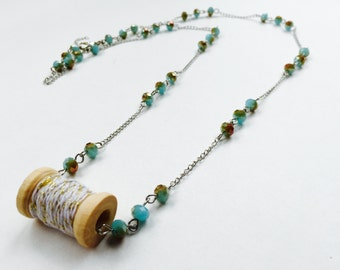 "Handmade Pendant Necklace - Wooden Spool with White/Gold thread & Blue/Brown iridescent beads on 14"" chain"