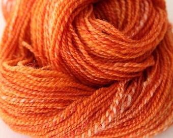 Hand spun 2ply DK wool/silk Fire