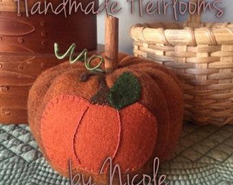 """Wool applique pumpkin using motif by """"Under the Garden Moon"""""""