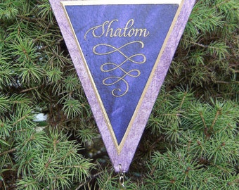 Shalom, a hand-crafted ornament with archival materials; made of approximately 70% recycled material