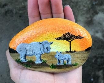 Original hand painted rocks, rhinos