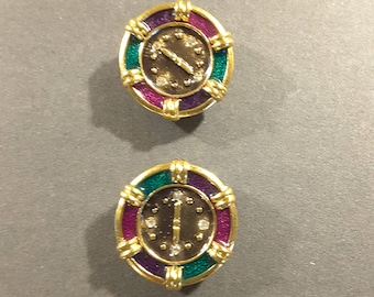 Two 1980's German enamel watch face buttons.