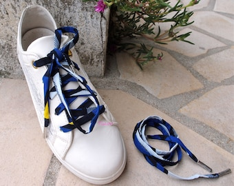 Shoe laces in yellow and blue wax fabric