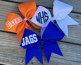Ribbon custom cheer bows with your name/team name in glitter.