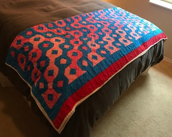 Vintage quilt, pink, blue and peach with red border, hand quilted