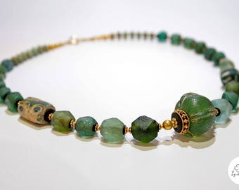 Ancient roman glass necklace with gold