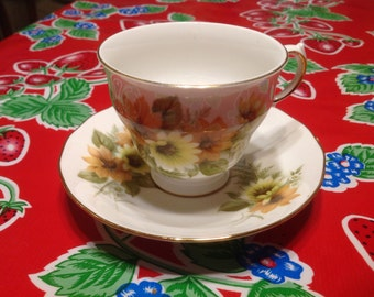 Vintage Royal Vale Fine Bone  China tea cup and saucer with floral designs- England