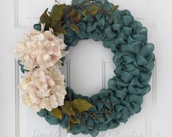 Fall, teal burlap wreath with cream hydrangeas and greenery