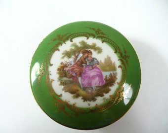 Vintage Limoges French porcelain trinket box with courting couple in green - 2-1/2 inches