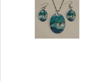 Glass cabochon pendant and earring set handpainted with alcohol ink