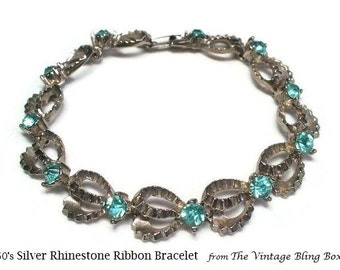 Aqua Blue Topaz Rhinestone Ribbons Bracelet with Pave Set Chaton Cut Crystals in Textured Silver Ribbon - Vintage 50's/60's Costume Jewelry