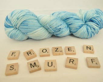 "Hand-dyed yarn, ""Frozen Smurf"" variegated, speckled, soft and squishy yarn. Great for socks or shawls. 80/20 Superwash wool/Nylon"