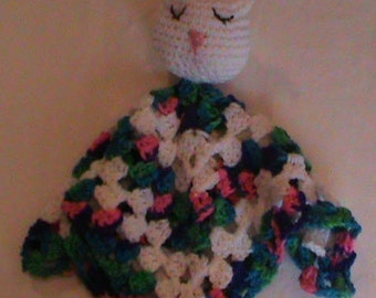 Crocheted white bunny lovee toy.