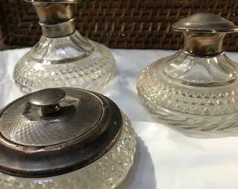 Trio of antique perfume and powder bottles